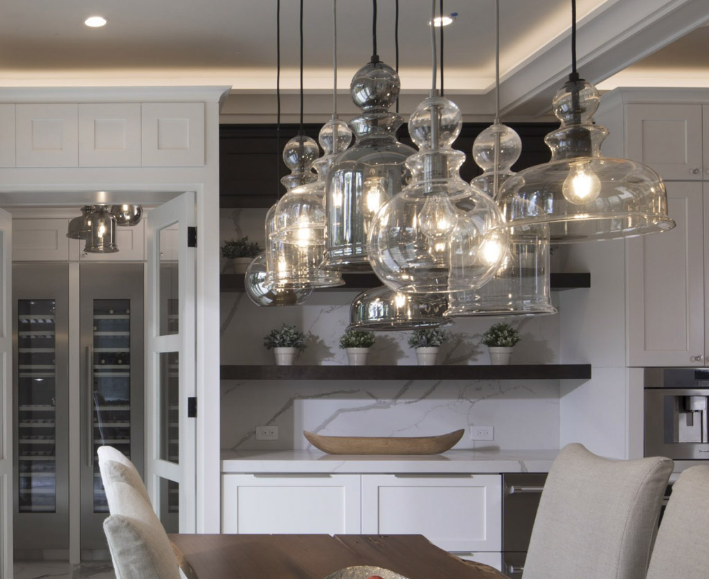 A cluster of Staunton pendants featured in the 2017 New American Remodeled Home by Phil Kean Design Group
